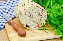 Cheese homemade with pepper and napkin on board Stock Photography