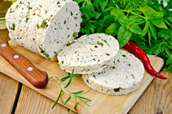 Cheese homemade with pepper and rosemary on board Royalty Free Stock Image