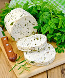 Cheese homemade with spices and napkin on board Royalty Free Stock Photos