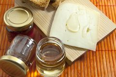 Cheese and honey Royalty Free Stock Image
