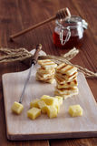 Cheese and honey appetizer. On a chopping board Stock Photo