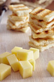 Cheese and honey appetizer. On a chopping board Royalty Free Stock Photography