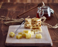 Cheese and honey appetizer. On a chopping board royalty free stock photo