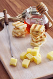 Cheese and honey appetizer. On a chopping board Stock Images