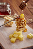 Cheese and honey appetizer. On a chopping board Stock Photos