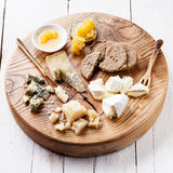 Cheese with honey and crackers Stock Image