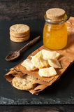 Cheese with honey and crispy cookies Stock Photo