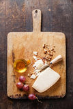 Cheese with honey, grapes and nuts Royalty Free Stock Image