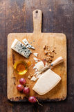 Cheese with honey, nuts and grapes Royalty Free Stock Photography