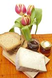 Cheese, honey and tulip Royalty Free Stock Images
