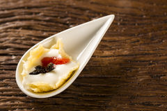 Cheese ice cream with guava confit in a spoon. Stock Photo
