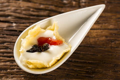 Cheese ice cream with guava confit in a spoon. Stock Photography