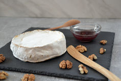 Cheese and jam on the stone table Royalty Free Stock Image