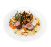 fried fillet of deer with assorted wild mushrooms  Royalty Free Stock Image