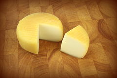 Cheese on kitchen board Royalty Free Stock Images