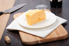 Cheese with knife Royalty Free Stock Photos