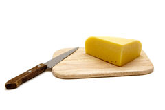 Cheese and Knife on a Cutting Board Stock Photography
