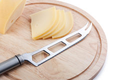 Cheese knife on cutting board Royalty Free Stock Images
