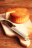 Cheese and knife Stock Photos