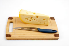 Cheese and knife on a wooden board Stock Photography