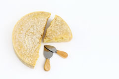 Cheese with knives on white background Royalty Free Stock Photography