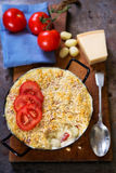Cheese macaroni bake. With gnocchi`s and tomatoes Royalty Free Stock Photo