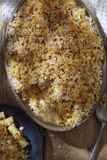 Cheese macaroni with breadcrumb topping. On wooden table Stock Photo