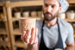 Cheese maker at the cellar Stock Photography