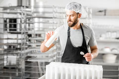 Cheese maker at the manufacturing Royalty Free Stock Image