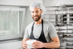 Cheese maker at the manufacturing Royalty Free Stock Photography