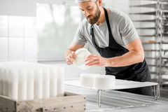 Cheese maker at the manufacturing Royalty Free Stock Photos