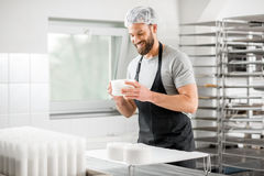 Cheese maker at the manufacturing Stock Images