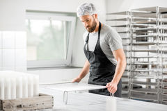 Cheese maker at the manufacturing Stock Photography