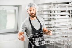 Cheese maker at the manufacturing Stock Photos
