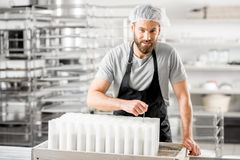 Cheese maker at the manufacturing Royalty Free Stock Photo