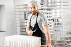 Cheese maker at the manufacturing Royalty Free Stock Images