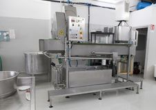 Cheese making machine L`Amordi Latte, a company that produces all types of cheese in Cavallino, Italy. Stock Photo