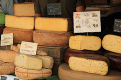 Cheese at a market stall Royalty Free Stock Images