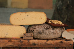 Cheese at a market stall Stock Photo