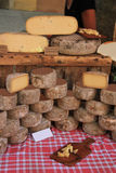 Cheese at a market stall Stock Photography