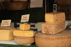 Cheese at a market stall Stock Photos