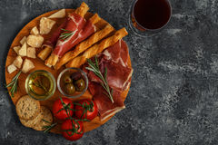 Cheese and meat appetizer selection. Prosciutto, parmesan, bread Royalty Free Stock Image