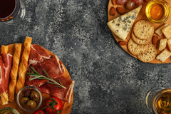 Cheese and meat appetizer selection, top view. royalty free stock images