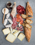 Cheese and meat appetizer selection or wine snack set. Variety of italian cheese, salami, bresaola, baguette, honey on Stock Photography