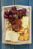 Cheese with meat, fruits Royalty Free Stock Images