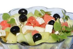 Cheese and melon salad stock images