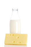 Cheese and milk bottle Royalty Free Stock Photography