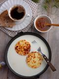Cheese in milk, cloudberry jam, and coffee Royalty Free Stock Image