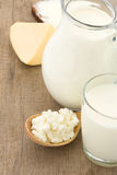 Cheese and milk products on wood Royalty Free Stock Photography