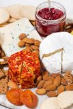 Cheese with mold and snacks, vertical top view Royalty Free Stock Photos